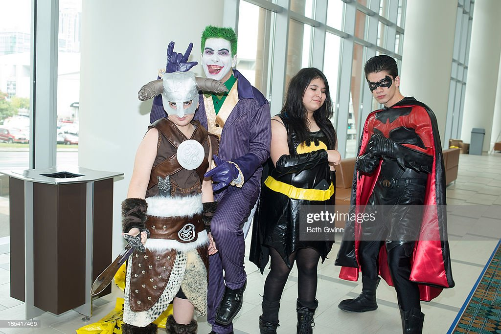 Elvis Hurtado as Dragon Boy, Miguel Hurado as Joker, Princely Chavez as Bat Girl, and Jorge Hurado as 1997 Robin attends Nashville Comic Con 2013 at Music City Center on October 19, 2013 in Nashville, Tennessee.
