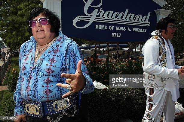 Elvis impersonators Carl Cassady of Frost Texas and Jim Schmidt of Delano Minnesota wait to visit Graceland the home of Elvis Presley August 15 2007...