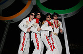 Elvis impersonators from Canada pose under the rings during the Closing Ceremony of the Sochi 2014 Winter Olympics at Fisht Olympic Stadium on...