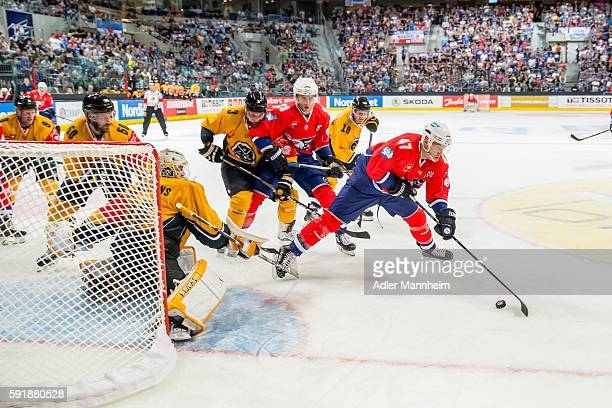 Elvis Merzlikins of HCL and Christoph Ullmann of Adler during the Champions Hockey League match between Adler Mannheim and HC Lugano at SAP on August...