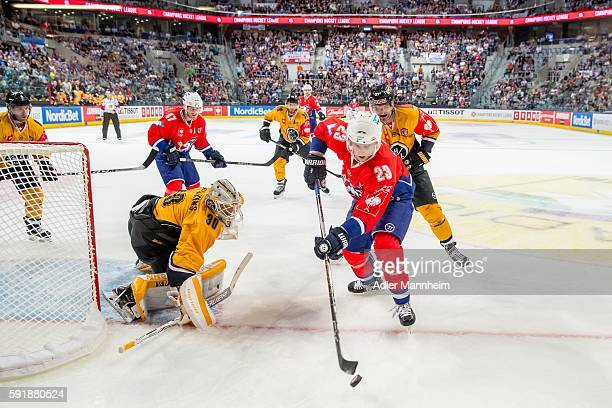 Elvis Merzlikins of HCL and Marcel Goc of Adler during the Champions Hockey League match between Adler Mannheim and HC Lugano at SAP on August 18...