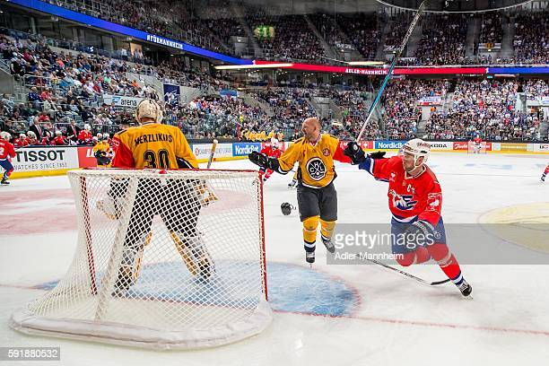 Elvis Merzlikins of HCL and Massimo Ronchetti of HCL Marcus Kink of Adler during the Champions Hockey League match between Adler Mannheim and HC...