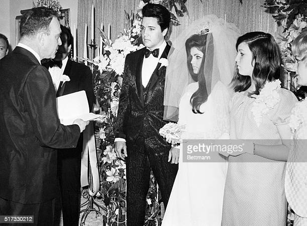 Elvis Presley and his bride the former Priscilla Ann Beaulieu are pronounced man and wife by Nevada Supreme Court Justice David Zenoff at the Aladdin...