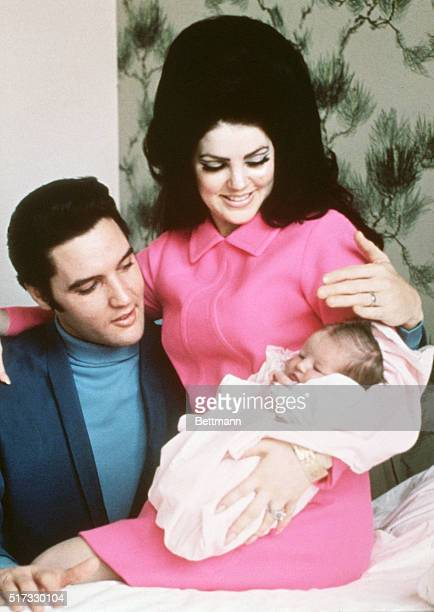 Elvis Presley and his wife Priscilla prepare to leave the hospital with their new daughter Lisa Marie Memphis Tennessee February 5 1968