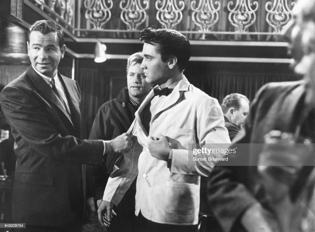 Elvis Presley and Walter Matthau on the set of 'King Creole' directed by Michael Curtiz