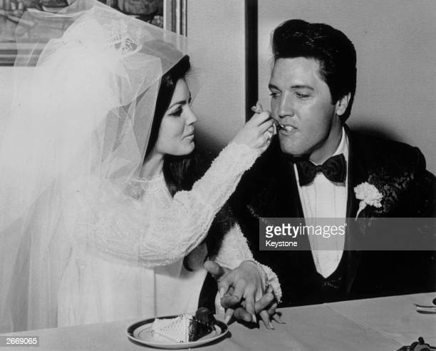 Elvis Presley being fed a mouthful of wedding cake by his bride Priscilla Beaulieu at the Aladdin Hotel Las Vegas