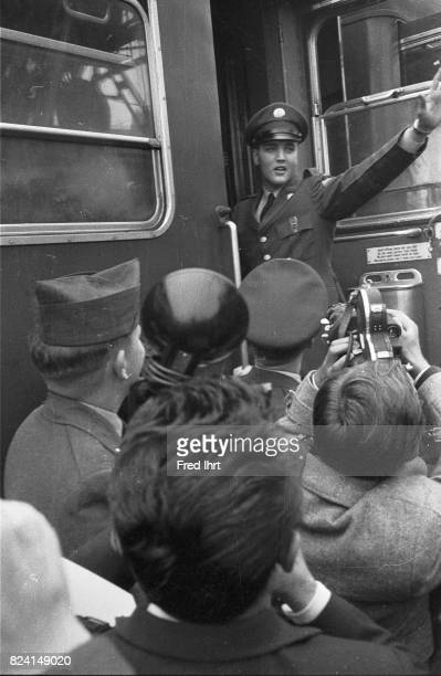 Elvis Presley getting into a train in Bremerhaven West Germany on Oktober 1 1958 He was 23 years old It was his first trip beyond North America...