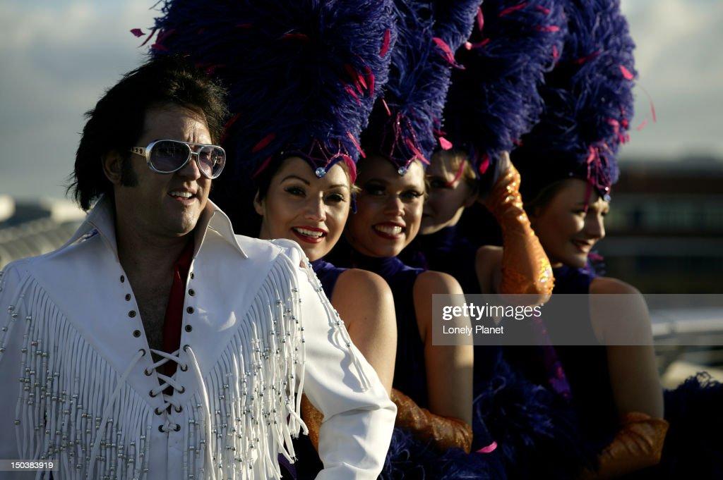 Elvis Presley impersonator and entourage on Millennium Bridge.