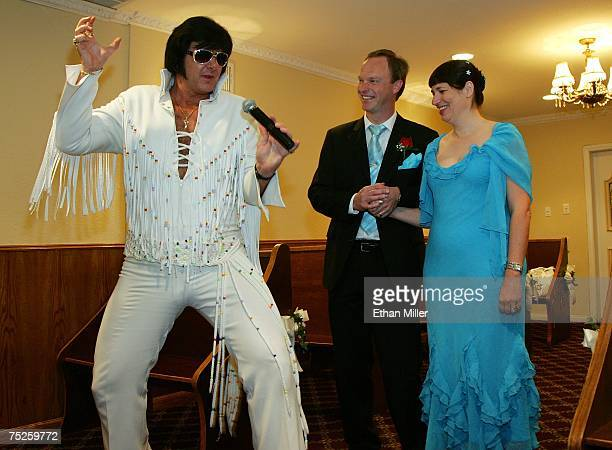 Elvis Presley impersonator Jeff Stanulis sings during the wedding ceremony for Anders Brusgard and Ingela Bonstrom of Sweden at the Graceland Wedding...