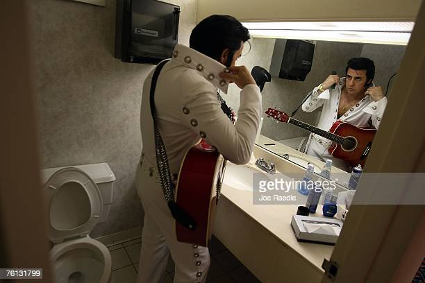Elvis Presley impersonator Lou Jordan from London England prepares for his turn to perform during an Images of the King competition at the Holiday...