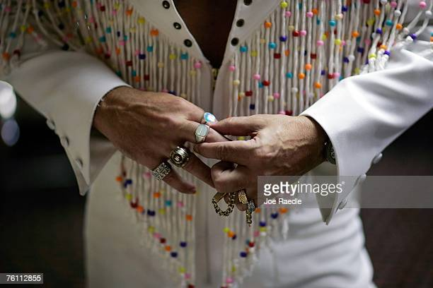 Elvis Presley impersonator Rodney Hamrick from Smiths Station Alabama puts on his jewelry as he prepares to perform during an Images of the King...