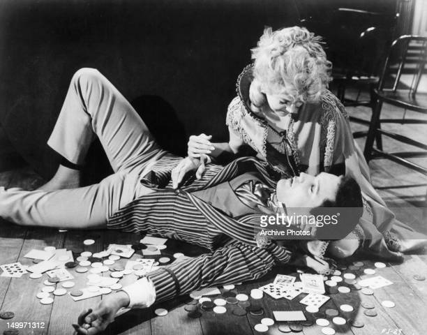 Elvis Presley is cradled by Donna Douglas on the floor in a scene from the film 'Frankie And Johnny' 1966