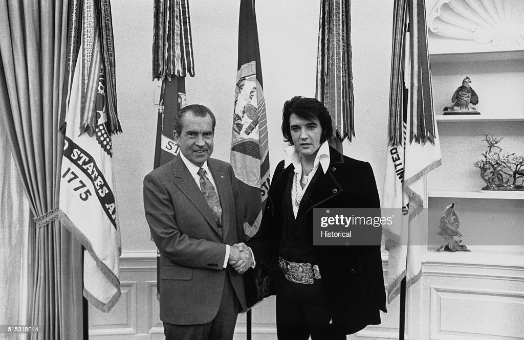 Elvis Presley shakes hands with President Richard Nixon in the Oval Office at the White House.