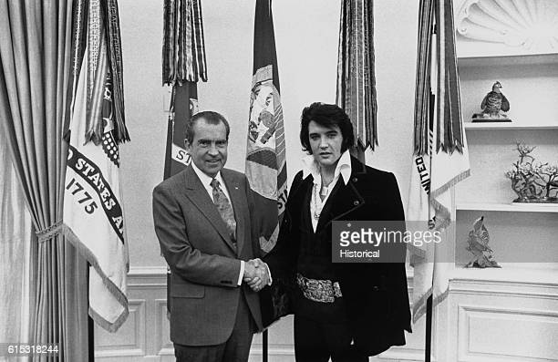 Elvis Presley shakes hands with President Richard Nixon in the Oval Office at the White House
