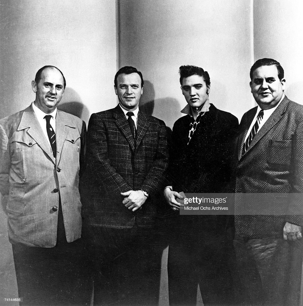 Elvis Presley with Colonel Tom Parker Eddy Arnold and Steve Sholes at the RCA Recording studios for his last recording session for two years on March...