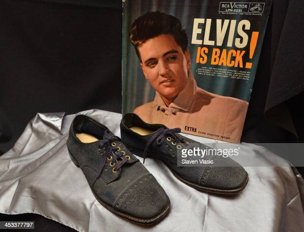 Elvis Presley's blue suede size 10 shoes from 1960 on display at 'Icons Idols Rock n' Roll' on December 3 2013 in New York City