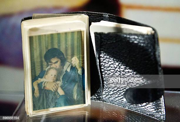 Elvis Presley's wallet containing a picture of his with daughter Lisa Marie part of 'Elvis at the O2 Direct from Graceland' exhibition in London...