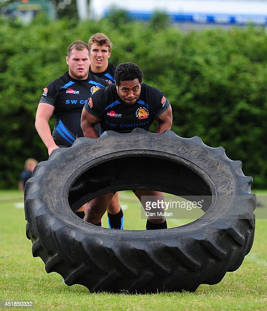 Elvis Taione of Exeter Chiefs flips a tyre during a training session at the University of Exeter on July 8 2014 in Exeter England