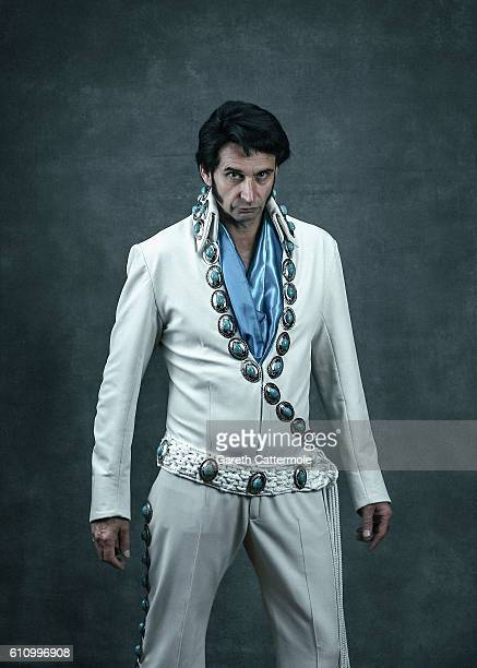 Elvis tribute artist Ady Holloway poses at the Grand Pavillion during a portrait session at 'The Elvies' on September 24 2016 in Porthcawl Wales 'The...