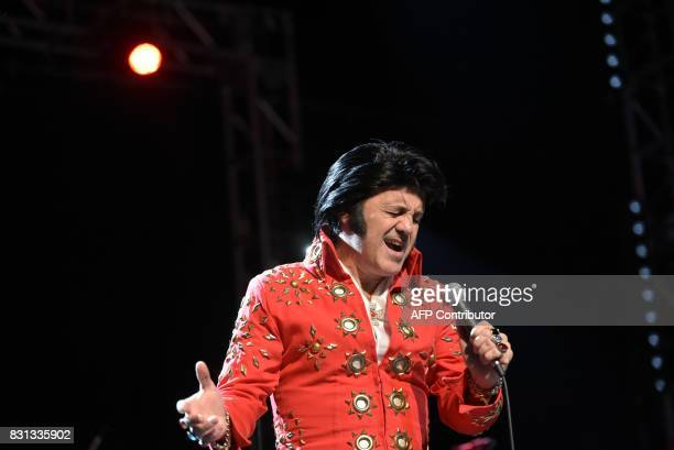 Elvis tribute artist Ede Danna of Brazil performs during the preliminary round of the 'Images of the King' contest at the New Daisy Theatre on August...