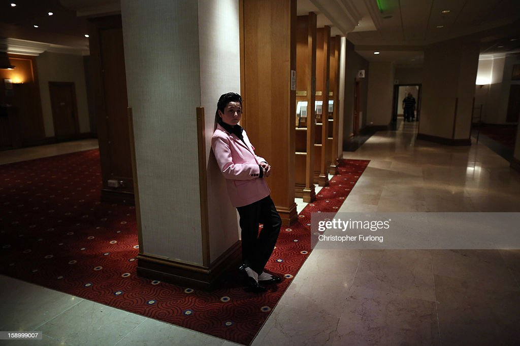 Elvis tribute artist Elias Boswell, aged 12, waits to take part in the European Elvis Championships at the Hilton Hotel on January 4, 2013 in Birmingham, England. Elvis impersonators are taking part in three days of competition from which a winner will go forward to the International Elvis Tribute Artist Contest in Memphis, USA.