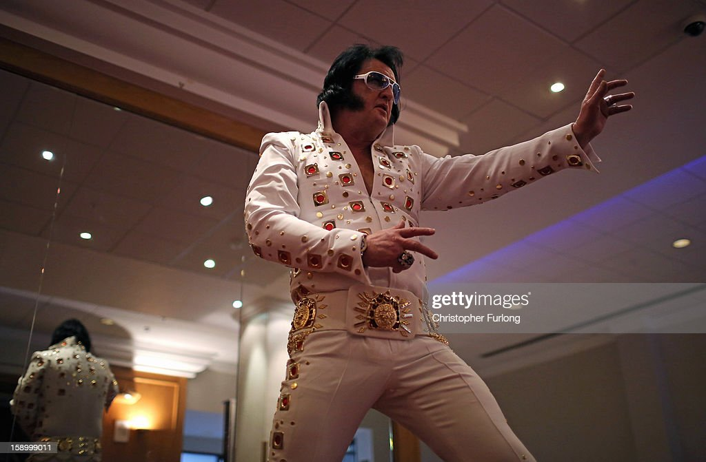 Elvis tribute artist Elvin Priestley poses as he tries on his new jump suit during European Elvis Championships at the Hilton Hotel on January 4, 2013 in Birmingham, England. Elvis impersonators are taking part in three days of competition from which a winner will go forward to the International Elvis Tribute Artist Contest in Memphis, USA.