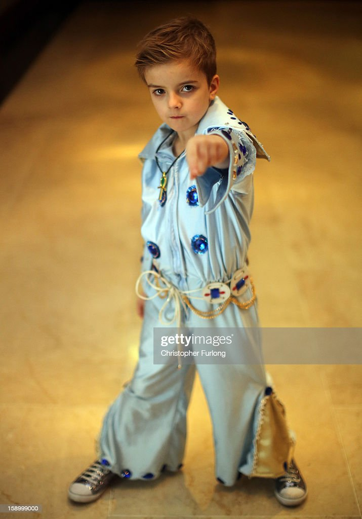 Elvis tribute artist John Paul Mellings, aged 6, poses as he waits to take part in the European Elvis Championships at the Hilton Hotel on January 4, 2013 in Birmingham, England. Elvis impersonators are taking part in three days of competition from which a winner will go forward to the International Elvis Tribute Artist Contest in Memphis, USA.