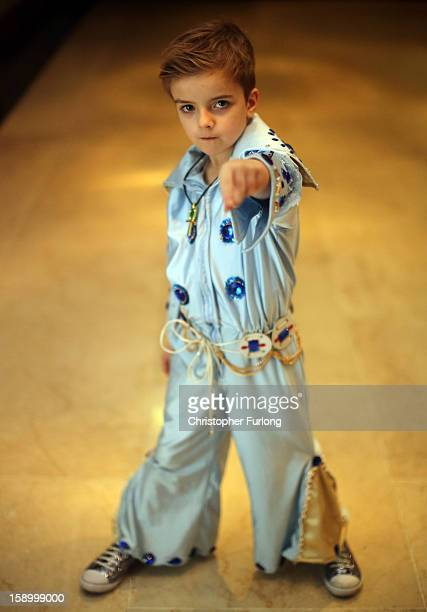 Elvis tribute artist John Paul Mellings aged 6 poses as he waits to take part in the European Elvis Championships at the Hilton Hotel on January 4...