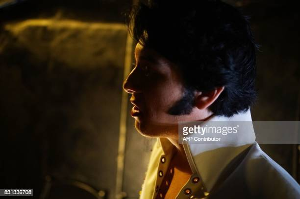 Elvis tribute artist Matthew Boyce is seen backstage before the preliminary round of the 'Images of the King' contest at the New Daisy Theatre on...
