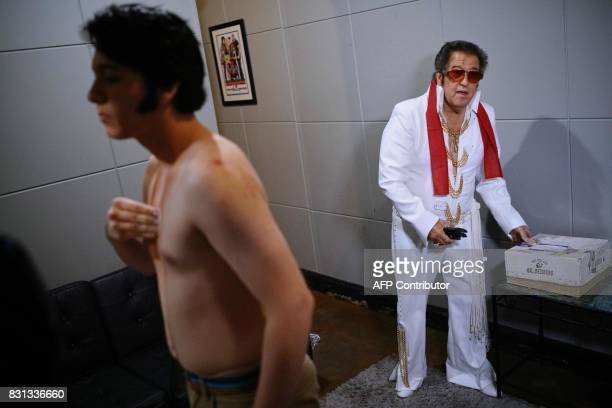 Elvis tribute artist Matthew Boyce is seen with fellow performer Jim Cardwell in a dressing room as he dresses for the preliminary round of the...