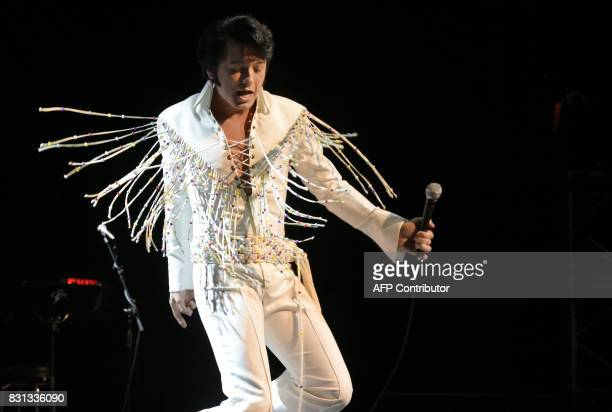 Elvis tribute artist Matthew Boyce performs during the preliminary round of the 'Images of the King' contest at the New Daisy Theatre on August 12...