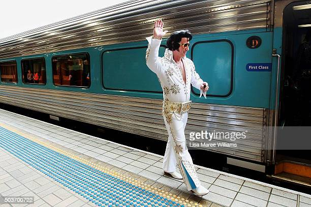 Elvis tribute artist prepares to board the 'Elvis Express' at Central Station on January 7 2016 in Sydney Australia The Parkes Elvis Festival is held...