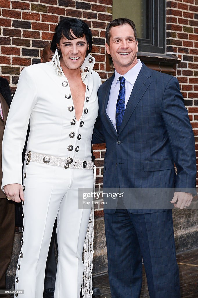 Elvis tribute artist Shawn Klush (L) and professional football coach <a gi-track='captionPersonalityLinkClicked' href=/galleries/search?phrase=John+Harbaugh&family=editorial&specificpeople=763525 ng-click='$event.stopPropagation()'>John Harbaugh</a> enter the 'Late Show With David Letterman' taping at the Ed Sullivan Theater on February 7, 2013 in New York City.