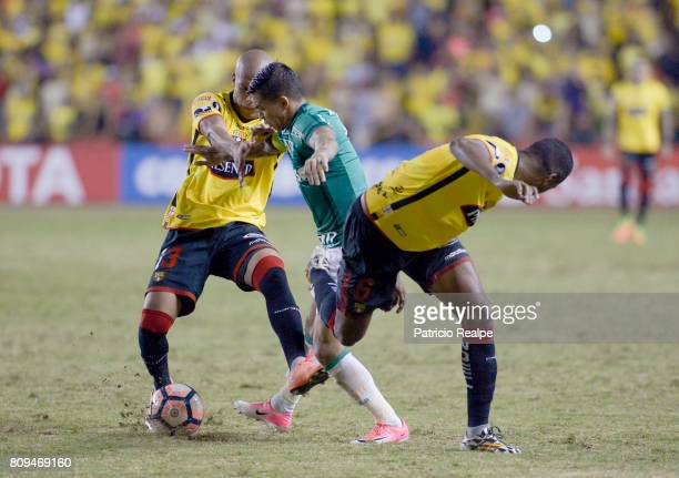Ely Esterilla of Barcelona fights for the ball with Eduardo Pereira Rodrigues of Palmeiras during a first leg match between Barcelona SC and...