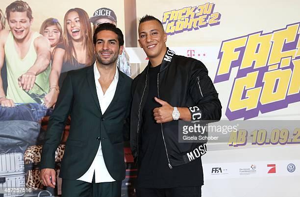 Elyas M'Barek Singer Farid Bang during the world premiere of 'Fack ju Goehte 2' at Mathaeser Kino on September 7 2015 in Munich Germany