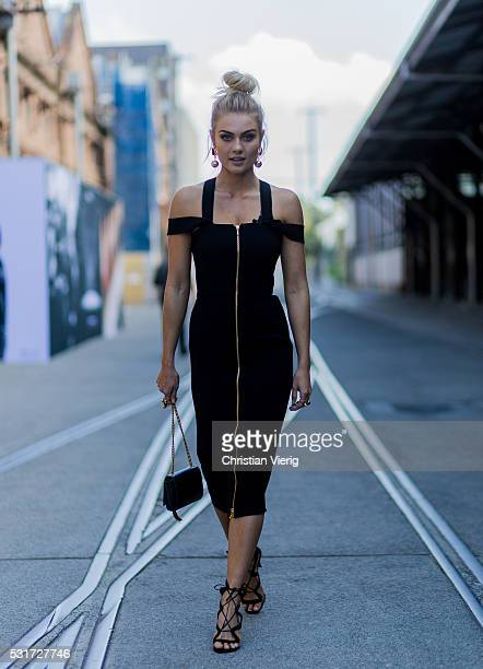 Elyse Knowles wearing a black off shoulder dress outside Yeojin Bae at MercedesBenz Fashion Week Resort 17 Collections at Carriageworks on May 16...