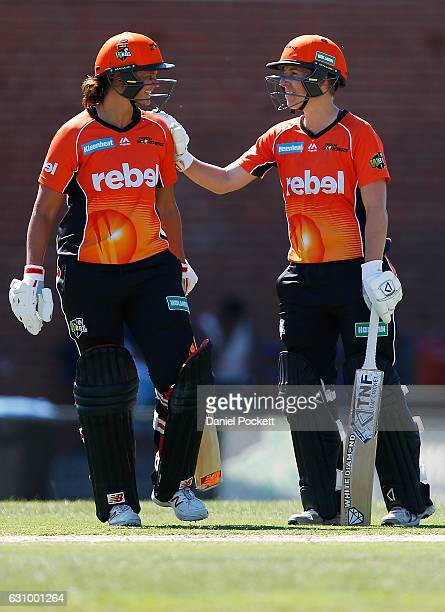 Elyse Villani of the Scorchers congratulates Suzie Bates of the Scorchers on reaching 50 runs during the Women's Big Bash League match between the...