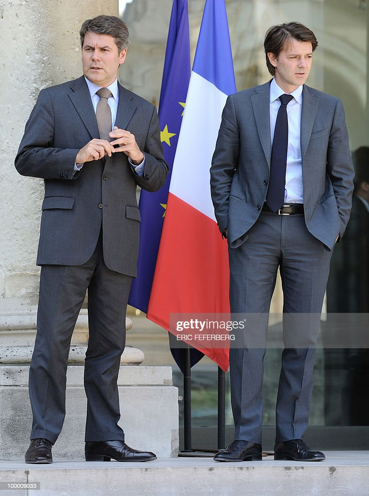 Elysee communication adviser Franck Louvrier (L) and Budget minister Francois Baroin (R) leave the Elysee Palace on May 20, 2010 in Paris to attend a second meeting on public deficit with French President Nicolas Sarkozy. France reopened its 2010 budget to add in the 111 billion euros it has promised to contribute to Europe's new 750-billion-euro emergency stability fund, Finance Minister Christine Lagarde said yesterday.
