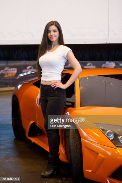 Elysia Wren poses infront of a Lamborghini Murcielago from The Fate of the Furious during the 'Fast Furious Live' media launch day event at the Fast...