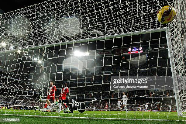 <em11 of Real Madrid CF scores their opening goal during the La Liga match between Real Madrid CF and Rayo Vallecano de Madrid at Estadio Santiago...