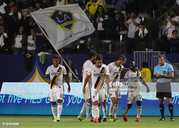 Ema Boateng of Los Angeles Galaxy second from right is congratulated by teammate Daniel Steres after Boateng scored his second goal in the first half...