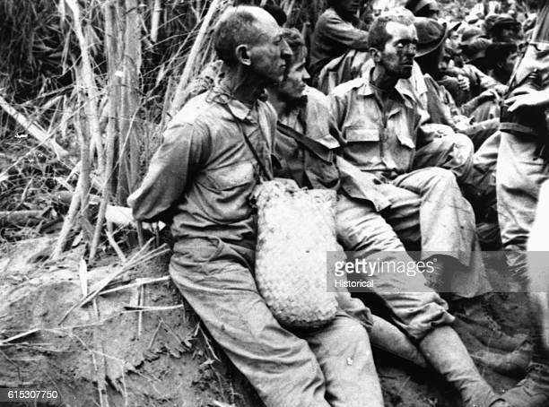 Emaciated American prisoners on the Bataan Death March have their hands tied behind their backs After the Japanese captured Bataan in April 1942 they...