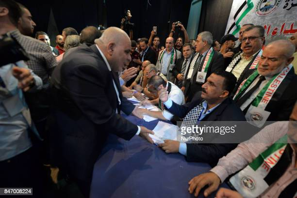 Emad zaanoun whose son was killed in 2007 during clashes between the rival Hamas and Fatah factions signs a social reconciliation agreement during a...