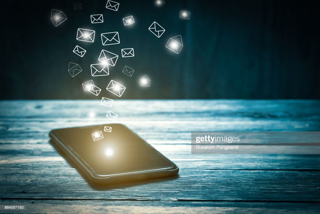 Email marketing and many envelopes in smartphone screen : Stock Photo