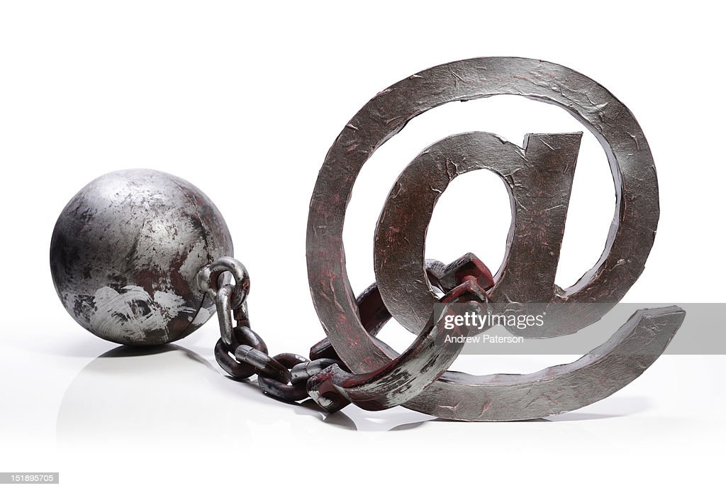 @ email symbol manacled to a ball and chain : Stock Photo