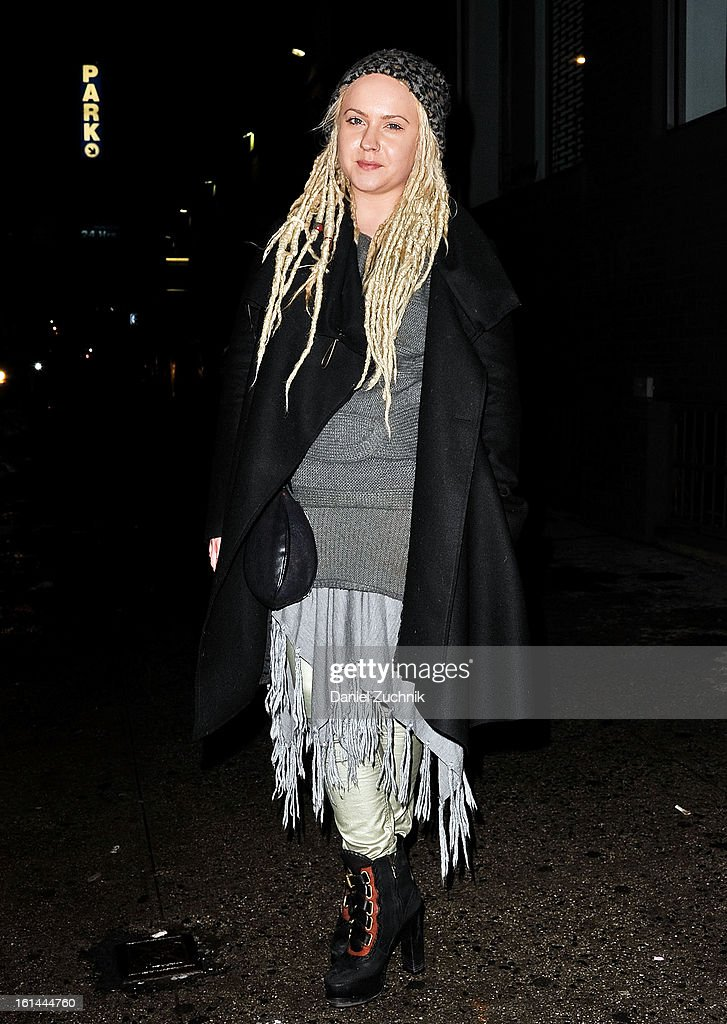 Emalynne Brushey, casting director for Style Like You, seen outside the Public School presentation wearing a vintage knit dress, All Saints coat, Helmut Lang bag, Rag and Bone pants and shoes on February 10, 2013 in New York City.