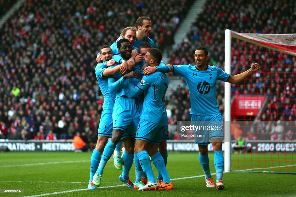 Emanuel Adebayor (2nd L) of Spurs celebrates with teammates after scoring his team's third goal during the Barclays Premier League match between Southampton and Tottenham Hotspur at St Mary's Stadium on December 22, 2013 in Southampton, England.