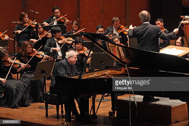 Emanuel Ax performing Chopin's 'Piano Concerto in F minor' with the New York Philharmonic led by David Robertson at Avery Fisher Hall on Wednesday...