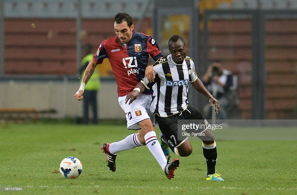 Emanuel Badu (R) of Udinese Calcio competes with Francesco Lodi of Genoa CFC during the Serie A match between Udinese Calcio and Genoa CFC at Stadio Friuli on September 24, 2013 in Udine, Italy.