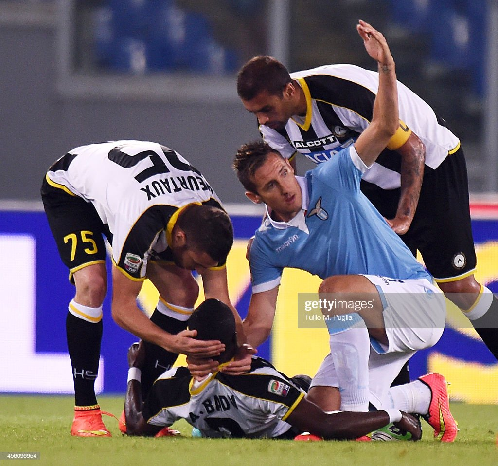 Emanuel Badu (C) of Udinese lies on the pitch after an injury during the Serie A match between SS Lazio and Udinese Calcio at Stadio Olimpico on September 25, 2014 in Rome, Italy.
